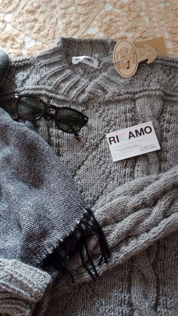 maglione con trecce e rombi