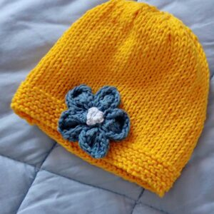 Baby hat with knitting flower